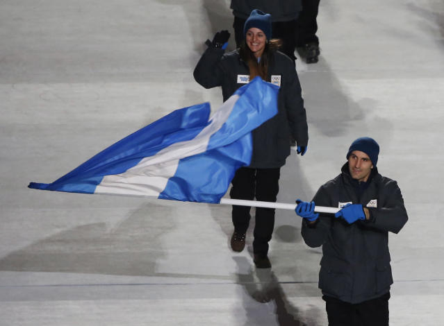 Argentina's flag-bearer Cristian Simari Birkner leads his country's contingent during the opening ceremony of the 2014 Sochi Winter Olympics, February 7, 2014. REUTERS/Lucy Nicholson (RUSSIA - Tags: OLYMPICS SPORT)