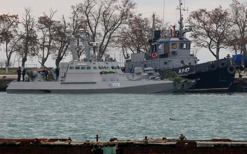 Russia is set to return Ukrainian navy ships seized a year ago, as it prepares for a summit to try to resolve the wider conflict  - AFP