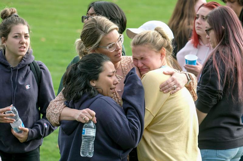 Students are comforted as they wait to be reunited with their parents following the shooting at Saugus High School. (Photo: ASSOCIATED PRESS)