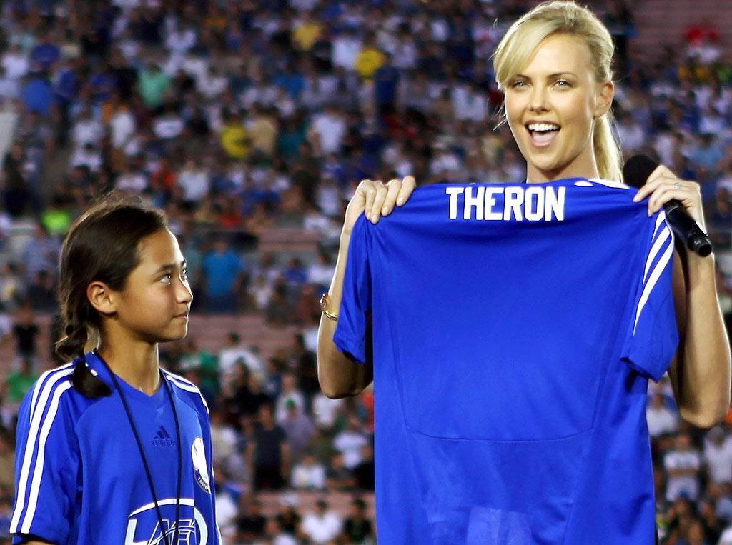 """Charlize Theron was on hand to raise awareness for her Africa Outreach Project, which teamed up with a Chelsea youth soccer program to sponsor organized sports for the poor in South Africa. Proceeds from Tuesday night's game went toward the project. Chris Weeks/<a href=""""http://www.wireimage.com"""" target=""""new"""">WireImage.com</a> - July 21, 2009"""
