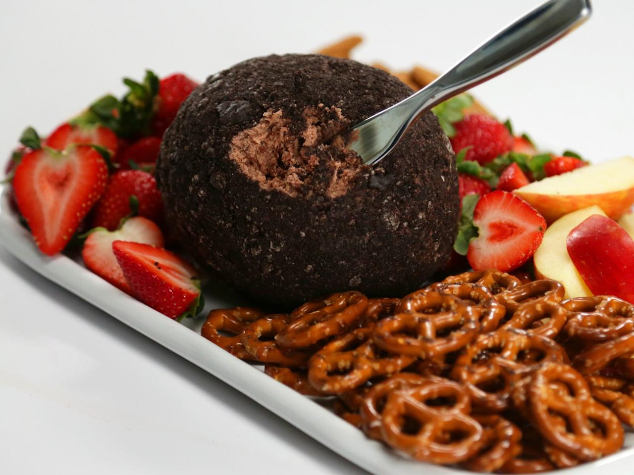 """<p>For an easy, no-bake treat that everyone will love, look no further than this decadent and chocolatey dessert cheese ball. Serve with dippers like strawberries, apple slices, and pretzels. It's like an easy-to-make (and easy-to-share) """"deconstructed"""" take on chocolate cheesecake.</p> <p><a href=""""https://www.myrecipes.com/recipe/chocolate-cookie-butter-cheese-ball"""">Chocolate Cookie Butter Cheese Ball&nbsp; Recipe</a></p>"""