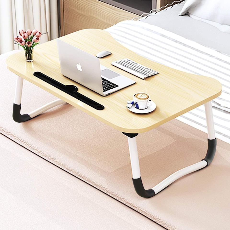 <p>If you prefer to work from your couch or bed, use this <span>Foldable Bed Tray Lap Desk</span> ($27).</p>