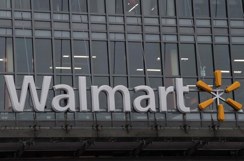 The Walmart logo is seen on a store in Washington, DC, on March 1, 2019. | Nicholas Kamm—AFP/Getty Images