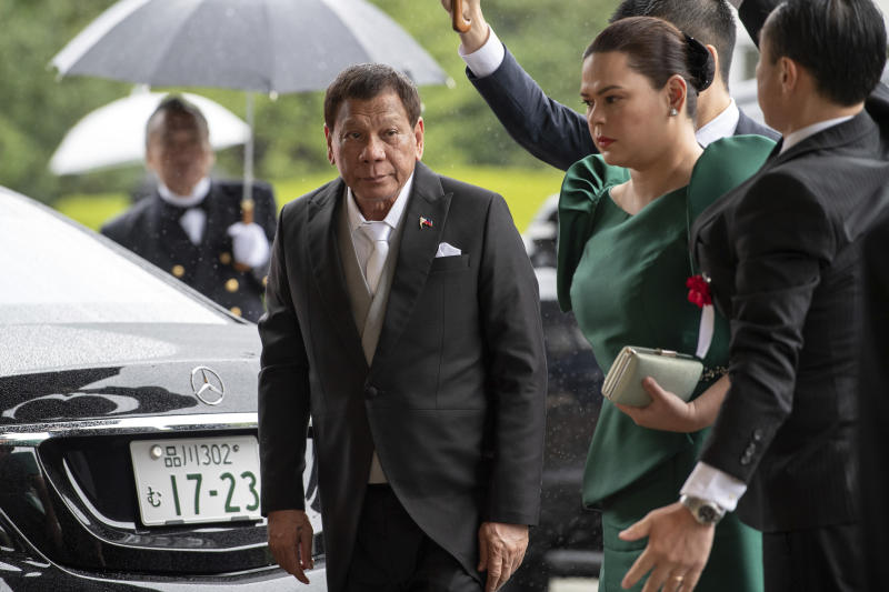 Philippines President Rodrigo Duterte arrives to attend the enthronement ceremony of Emperor Naruhito at the Imperial Palace in Tokyo, Tuesday, Oct. 22, 2019. (Carl Court/Pool Photo via AP)