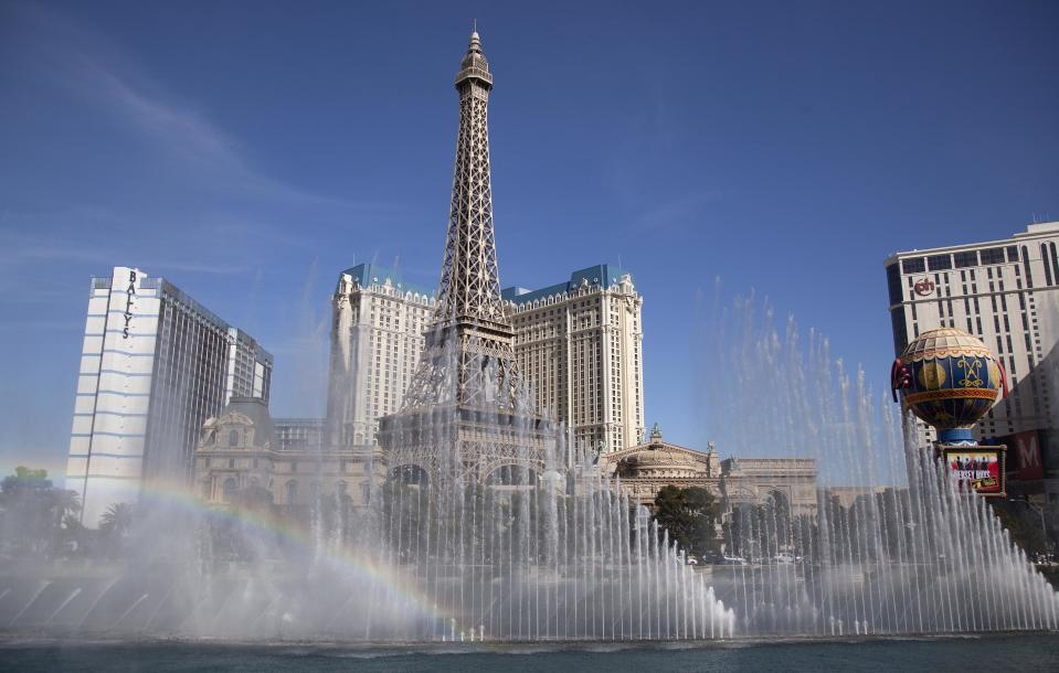FILE - This March 20, 2012 file photo shows the Bellagio fountain spraying in sync with music during one of its afternoon shows in Las Vegas. The Bellagio resort, with its romantic Italian-inspired architecture, is something of a crown jewel in the heart of the Strip. But when night falls, the real stars are the majestic dancing fountains that emerge from the vast man-made lake in front of the hotel. Illuminated columns of water shoot from hundreds of powerful pipes below the lake's surface, soaring to impossible heights and moving in sync to songs by Andrea Bocelli, Faith Hill and The Beatles. (AP Photo/Julie Jacobson, file)