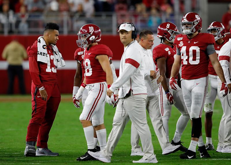 TUSCALOOSA, ALABAMA - OCTOBER 26: Tua Tagovailoa #13 of the Alabama Crimson Tide stands out on the field with the offense during a timeout in the game against the Arkansas Razorbacks at Bryant-Denny Stadium on October 26, 2019 in Tuscaloosa, Alabama. (Photo by Kevin C. Cox/Getty Images)