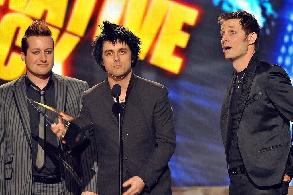 Tre Cool, Billy Joe Armstrong and Mike Dirnt of Green Day onstage at the 2009 American Music Awards at Nokia Theatre L.A. Live on November 22, 2009 in Los Angeles, California.