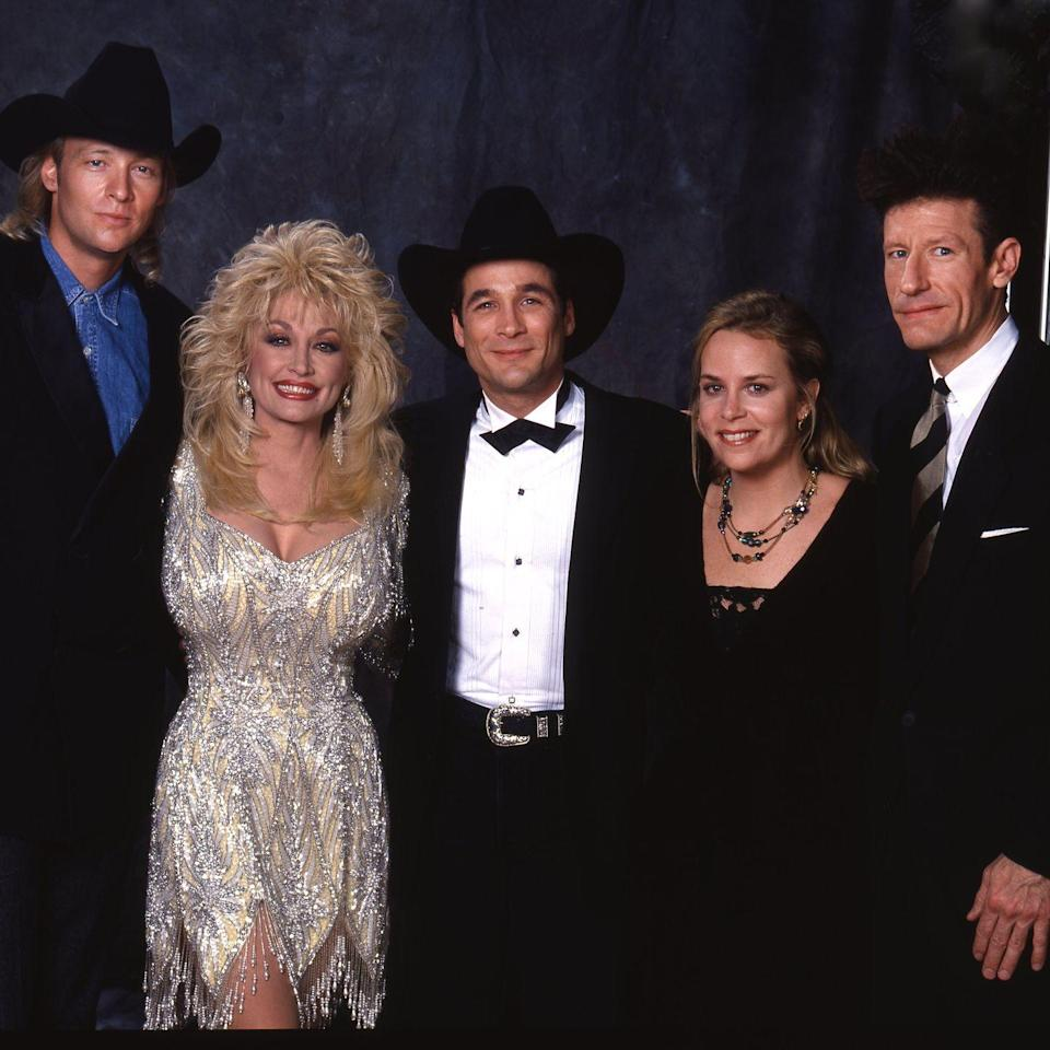 <p>Talk about a country music power photo. Dolly snaps a picture before the 1988 Country Music Awards with singer-songwriters Alan Jackson, Clint Black, Mary Chapin Carpenter, and Lyle Lovett.</p>