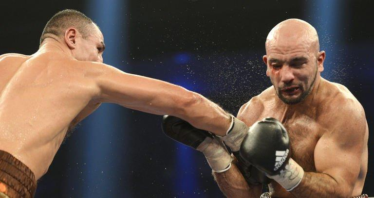 Armenian-German super middleweight boxer Arthur Abraham (L) punches French challenger Mehdi Bouadla during the WBO Super-middleweight title boxing match in Nuremberg, southern Germany on December 15, 2012. Abraham won the fight in the 8th round