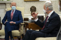 Sen. Tom Carper, D-Del., right, speaks to President Joe Biden during a meeting with lawmakers on investments in infrastructure, in the Oval Office of the White House, Thursday, Feb. 11, 2021, in Washington. (AP Photo/Evan Vucci)