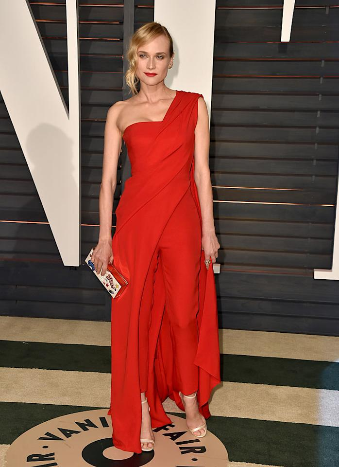 <p>The actress was a vision in red at the 2015 <i>Vanity Fair</i> Oscar Party. She paired the dramatic red jumpsuit, which features an over-cape, with a fun Anya Hindmarch clutch and Jimmy Choo sandals. Her red lips perfectly completed the look. <em>(Photo: Getty Images)</em> </p>