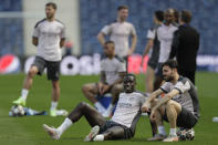 Manchester City's Benjamin Mendy, left, talks to teammate Bernardo Silva during a training session ahead of the Champions League final match at the Dragao stadium in Porto, Portugal, Friday, May 28, 2021. Manchester City and Chelsea will play the Champions League final on Saturday. (AP Photo/Manu Fernandez)