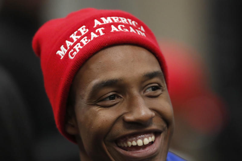 A supporter of President Donald Trump waits for Trump to arrive for a Black Voices for Trump rally Friday, Nov. 8, 2019, in Atlanta. (AP Photo/John Bazemore)
