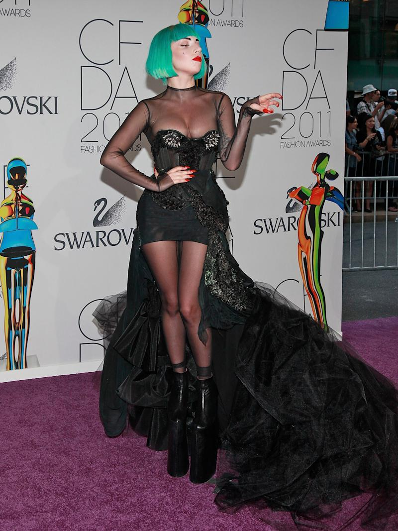 At the CFDA awards sporting a teal bob. She won the Fashion Icon Award that evening.