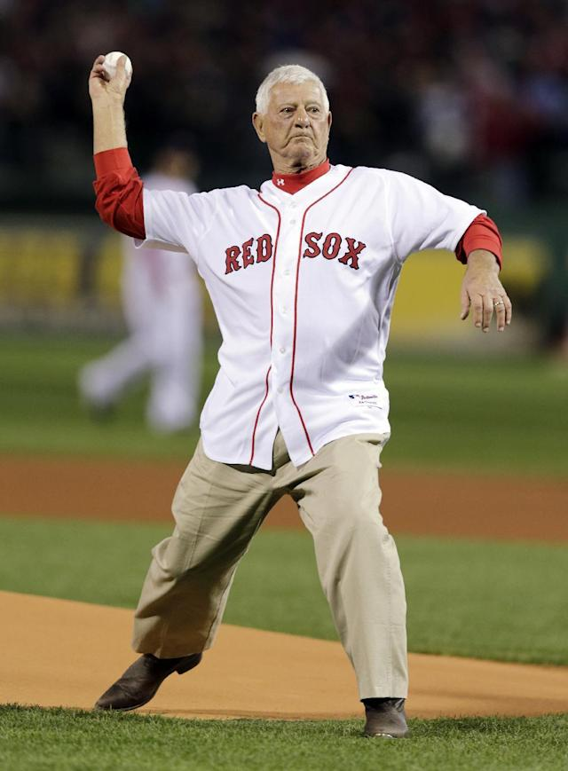 Former Boston Red Sox Carl Yastrzemski throws out a ceremonial first pitch before Game 1 of baseball's World Series against the St. Louis Cardinals Wednesday, Oct. 23, 2013, in Boston. (AP Photo/Charles Krupa)