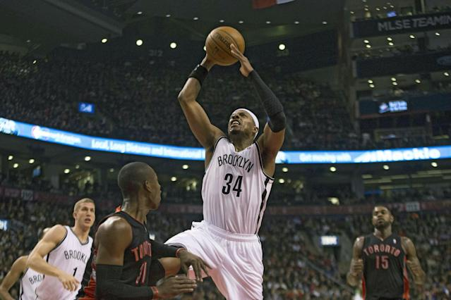 Brooklyn Nets Paul Pierce (34) shoots on Toronto Raptors' Terrence Ross during the first half of an NBA basketball game, Saturday, Jan. 11, 2014 in Toronto (AP Photo/The Canadian Press, Chris Young)