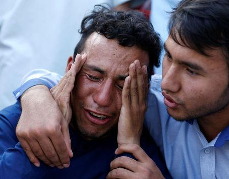 An Afghan man weeps outside a hospital after a suicide attack in Kabul, Afghanistan July 23, 2016. REUTERS/Mohammad Ismail