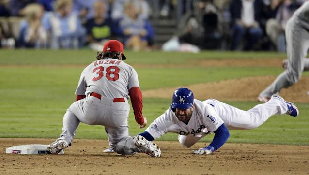 St. Louis Cardinals' Pete Kozma (38) makes the tag as Los Angeles Dodgers' Nick Punto is picked off second during the seventh inning of Game 4 of the National League baseball championship series Tuesday, Oct. 15, 2013, in Los Angeles. (AP Photo/Chris Carlson)