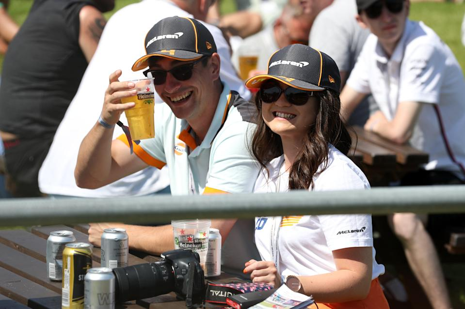 Spectators found ways to keep cool ahead of the action on track (Bradley Collyer/PA) (PA Wire)