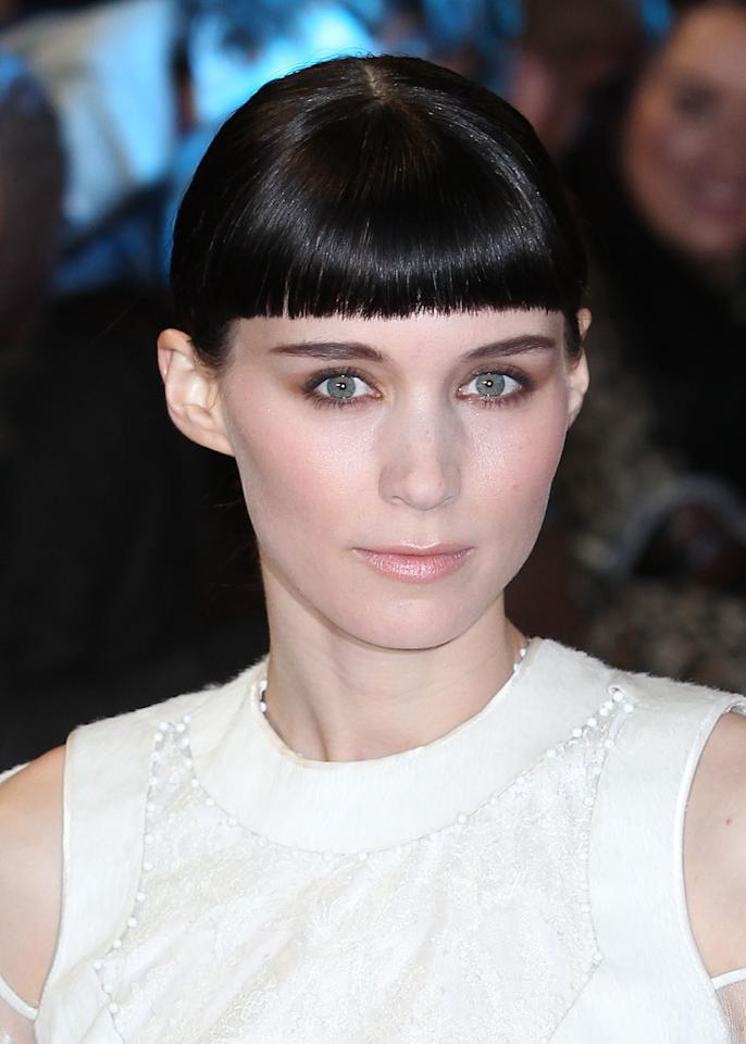 "In this Dec. 12, 2011 file photo, actress Rooney Mara, who plays Lisbeth Salander, arrives for the World Premiere of ""The Girl With The Dragon Tattoo,"" in London. Mara was nominated Tuesday, Jan. 24, 2012 for an Academy Award for best actress for her role in the film. The Oscars will be presented Feb. 26 at the Kodak Theatre in Los Angeles, hosted by Billy Crystal and broadcast live on ABC.(AP Photo/Joel Ryan, file)"