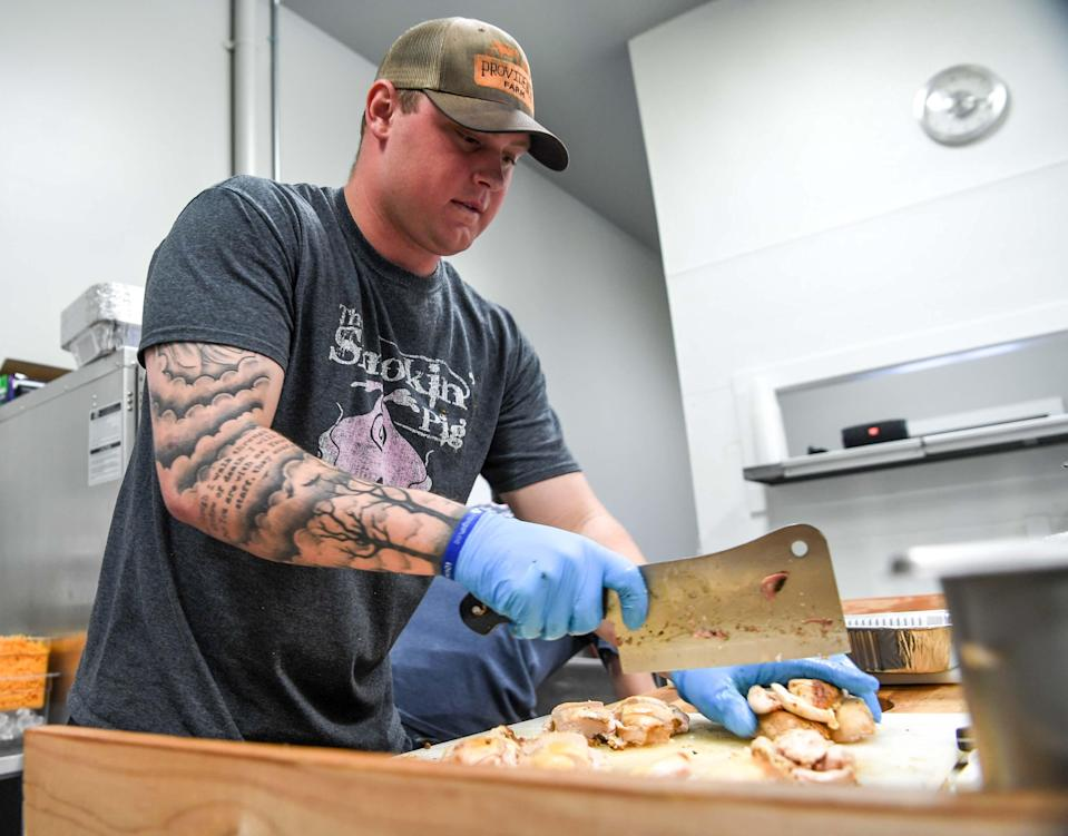Chase McCroskey prepares smoked chicken at The Smokin' Pig's new location on Evergreen Road, off of State Highway 81 North in Anderson, which opened February 28, 2019. The new location is the fourth, with locations in Pendleton, Williamston, and Easley.