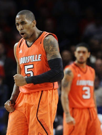 Louisville's Chris Smith (5) reacts to a play during the second half of an NCAA college basketball game against Cincinnati in the final of the Big East Conference tournament in New York, Saturday, March 10, 2012. (AP Photo/Frank Franklin II)