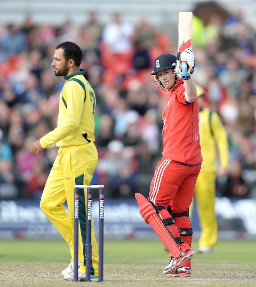 England's Eoin Morgan celebrates his half century against Australia, during the Second One Day International at Old Trafford Cricket Ground, Manchester.