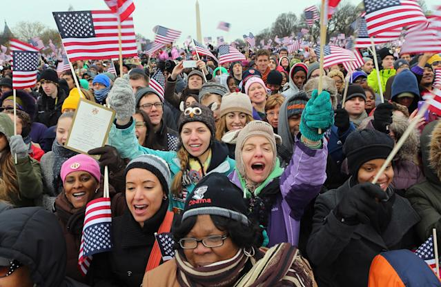 People cheer as on the National Mall during the Inauguration ceremony on January 21, 2013 in Washington, DC. U.S. President Barack Obama was sworn in during his public ceremonial swearing-in ceremony for his second term today. (Photo by Joe Raedle/Getty Images)