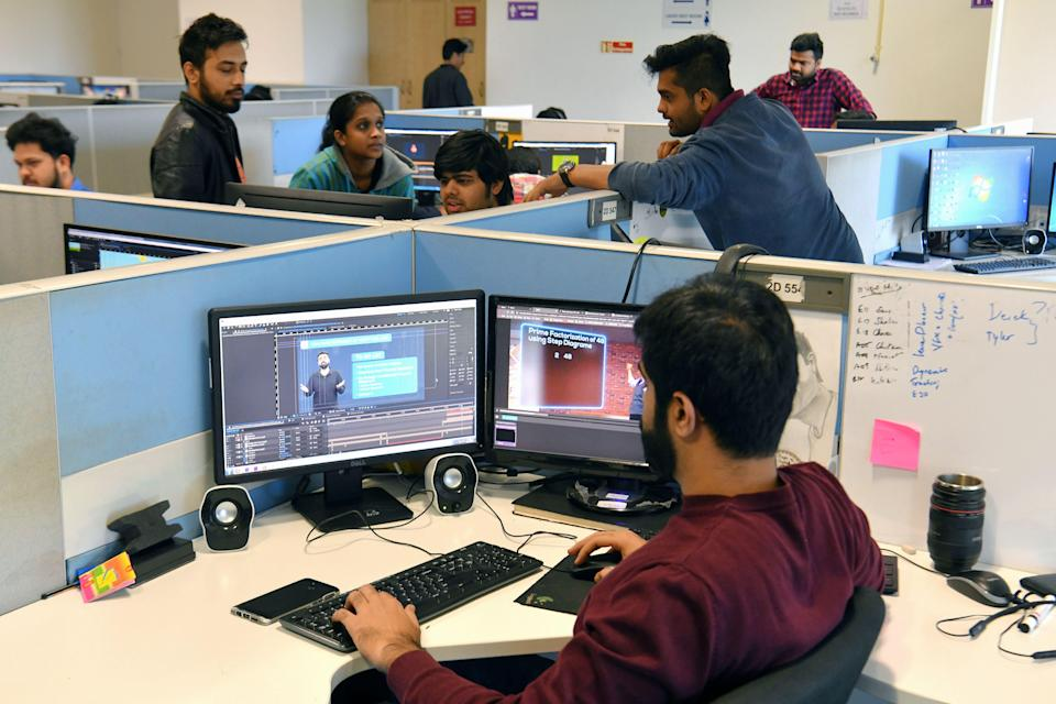 In this photo taken on January 10, 2019, employees of education technology start-up Byju's work on content development for the app at their office in Bangalore. - From a multi-billion-dollar education startup to wired-up mannequins, technology is helping to revolutionise the way Indian schoolchildren are learning -- provided their parents can afford it. (Photo by MANJUNATH KIRAN / AFP) / To go with 'INDIA-ECONOMY-EDUCATION-TECHNOLOGY-AMAZON-BYJU',FOCUS by Vishal MANVE (Photo credit should read MANJUNATH KIRAN/AFP via Getty Images)