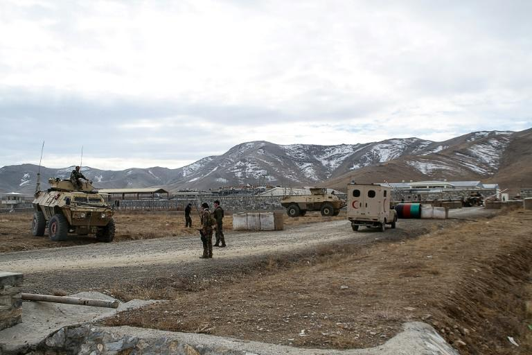 Security personnel near the army base hit by a suicide bomber on the outskirts of Ghazni