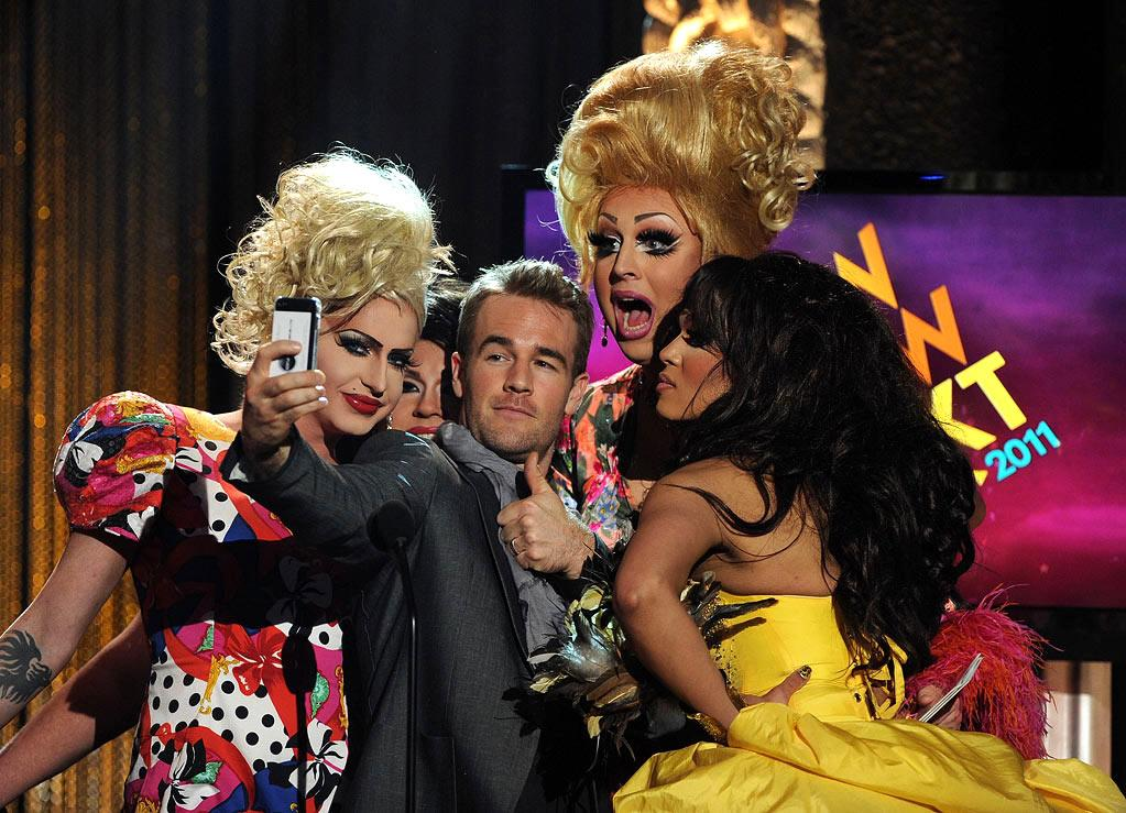 """Host James Van Der Beek captured the moment after being carried on stage by contestants from """"RuPaul's Drag Race"""" at Logo's 4th annual NewNowNext Awards at the Avalon in Hollywood on Thursday night. Kevin Winter/<a href=""""http://www.gettyimages.com/"""" target=""""new"""">GettyImages.com</a> - April 7, 2011"""