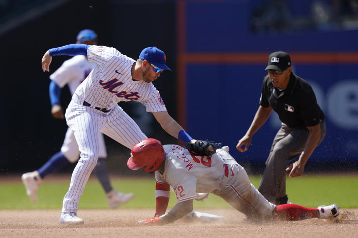 New York Mets second baseman Jeff McNeil (6) tags Philadelphia Phillies Andrew McCutchen (22) out at second base during the seventh inning of a baseball game, Sunday, June 27, 2021, in New York. McCutchen was ruled safe on the field but the call was reversed after a video review. (AP Photo/Kathy Willens)