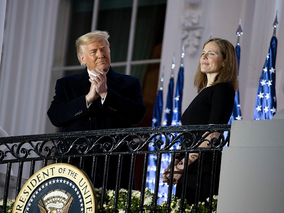 Donald Trump and the newly sworn-in Supreme Court Associate Justice Amy Coney BarrettGetty Images