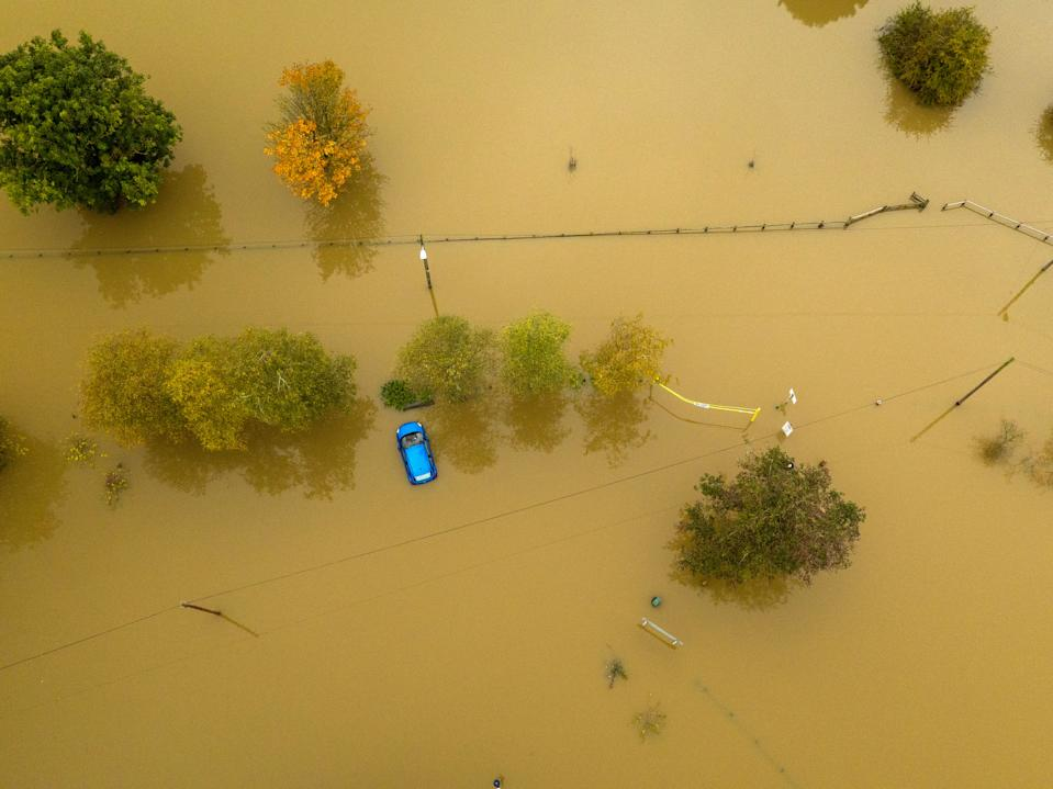 An aerial view of a car caught in flood water in Tewkesbury, Gloucestershire, as the UK has been hit by widespread flooding after rivers burst their banks following the weekend???s heavy rain.