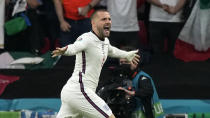 England's Luke Shaw celebrates after scoring the opening goal during the Euro 2020 soccer championship final between England and Italy at Wembley stadium in London, Sunday, July 11, 2021. (AP Photo/Frank Augstein, Pool)