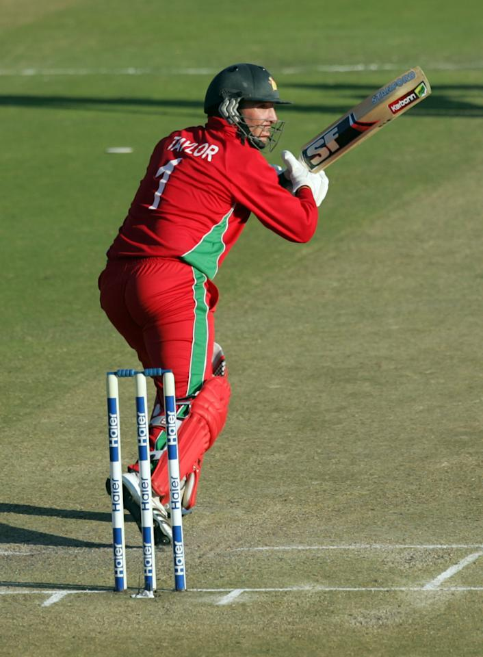 Zimbabwe captain Brendan Taylor bats during the first game of the three match ODI cricket series between Pakistan and hosts Zimbabwe at the Harare Sports Club on August 27, 2013. AFP PHOTO / JEKESAI NJIKIZANA        (Photo credit should read JEKESAI NJIKIZANA/AFP/Getty Images)