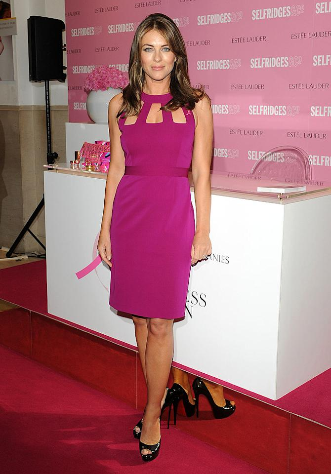 "And last but not least, we have Elizabeth Hurley -- who, at 47 -- continues to look stunning while remaining committed to the fight against breast cancer. Wearing a magenta cocktail frock and black patent leather peep-toes, the ageless beauty popped by Selfridges in London to raise money and awareness for the disease. Classy and classic. (10/9/2012)<br><br><a target=""_blank"" href=""http://omg.yahoo.com/news/hurley-still-gets-dressed-pink-october-193525134.html"">Hurley still gets dressed in pink every October</a>"