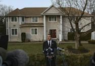 New York Governor Andrew Cuomo speaks to the media outside the home of Rabbi Chaim Rottenberg where the Hanukkah machete attack occurred