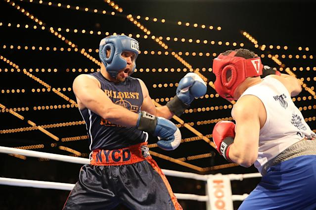 <p>Javier Colon, left, fights off Eddie Bermudez during the NYPD Boxing Championships at the Theater at Madison Square Garden on June 8, 2017. (Photo: Gordon Donovan/Yahoo News) </p>