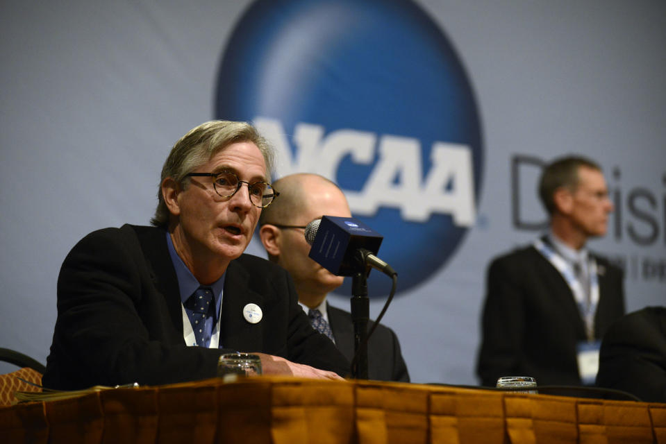 Dr. Brian Hainline speaks into a microphone.