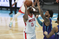 Houston Rockets center DeMarcus Cousins (15) shoots over Charlotte Hornets forward Miles Bridges in the first half of an NBA basketball game in Charlotte, N.C., Monday, Feb. 8, 2021. (AP Photo/Nell Redmond)
