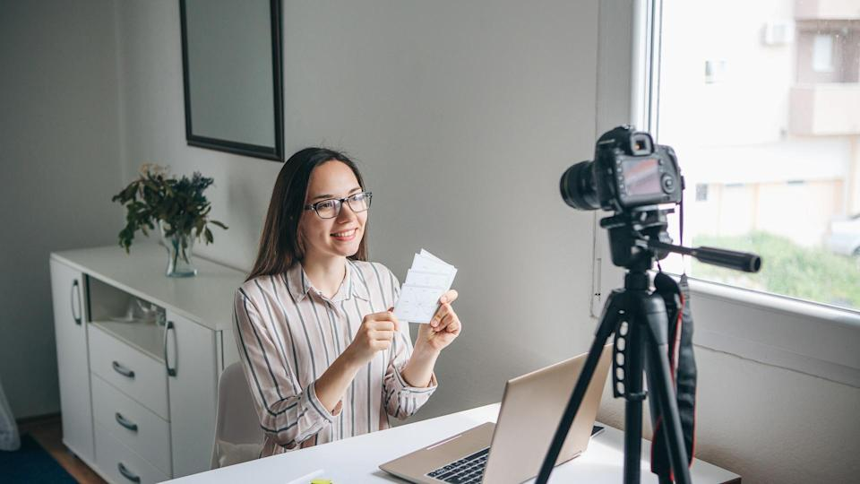Girl video blogger or online foreign language teacher writes a training video for their subscribers to upload to social networks.