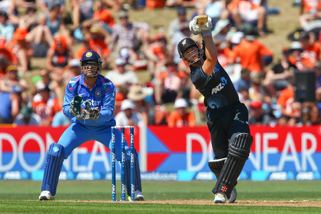NAPIER, NEW ZEALAND - JANUARY 19:  Kane Williamson of New Zealand bats while MS Dhoni of India looks on during the first One Day International match between New Zealand and India at McLean Park on January 19, 2014 in Napier, New Zealand.  (Photo by Hagen Hopkins/Getty Images)