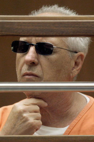 FILE - In this June 19, 2009 file photo, former Hollywood private eye Anthony Pellicano appears in court in Los Angeles. Four years after Pellicano went to prison for wiretapping phones of the rich and famous on behalf of celebrities and Hollywood heavyweights, his clients face hefty bills for his skullduggery. A Los Angeles County jury awarded nearly $4 million in the first of several lawsuits against Pellicano's well-heeled clients, in finding that the ex-wife of a billionaire philanthropist invaded the privacy of her three adult step-children and a former personal assistant. The verdict could spell trouble for other former clients who have been sued, such as Paramount studio head Brad Grey and one-time superagent Michael Ovitz. (AP Photo/Nick Ut, File)