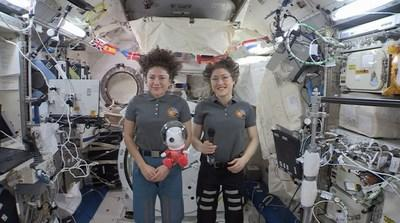 "World-Famous Beagle Snoopy—in 8-Inch Plush Form—Was ""Floating On Air"" with Astronauts Christina Koch and Jessica Meir as They Sent Greetings from the International Space Station to Millions of Macy's Parade Viewers, While a New 49-Foot Tall Astronaut Snoopy Macy's Parade Balloon Soared Over Manhattan. (CNW Group/DHX Media Ltd. (dba WildBrain))"