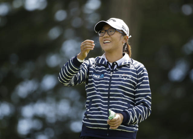 Lydia Ko, of New Zealand, smiles while checking the wind direction on the third tee of the Lake Merced Golf Club during the third round of the Swinging Skirts LPGA Classic golf tournament on Saturday, April 26, 2014, in Daly City, Calif. (AP Photo/Eric Risberg)
