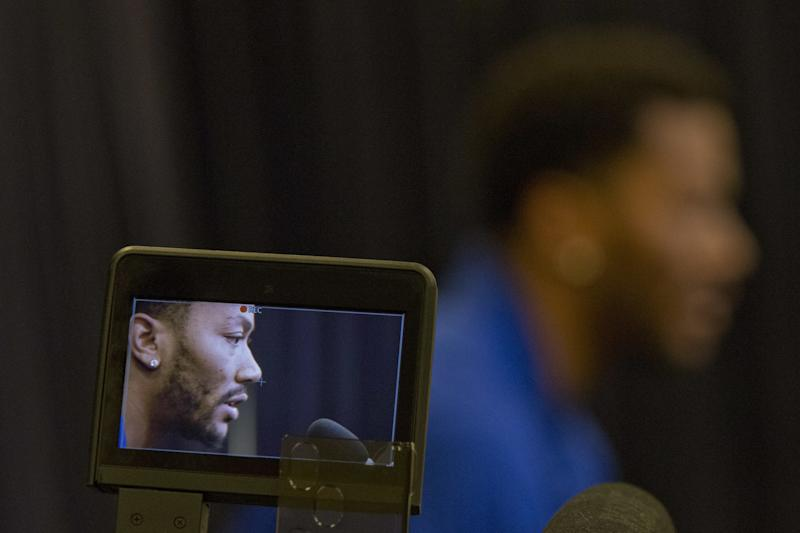 Derrick Rose is displayed on the screen of a video camera as he speaks during a news conference at Madison Square Garden, Friday, June 24, 2016, in New York. (AP/Mary Altaffer)