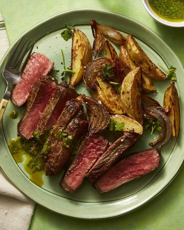 """<p>You can't go wrong with a classic steak and potatoes dinner. This Mother's Day recipe is zested up with a citrusy sauce made of cilantro, parsley, and basil.</p><p><a href=""""https://www.womansday.com/food-recipes/food-drinks/a26732227/herbed-mojo-steak-and-crispy-potatoes-recipe/"""" rel=""""nofollow noopener"""" target=""""_blank"""" data-ylk=""""slk:Get the recipe for Herbed Mojo Steak and Crispy Potatoes."""" class=""""link rapid-noclick-resp""""><em>Get the recipe for Herbed Mojo Steak and Crispy Potatoes.</em></a></p>"""