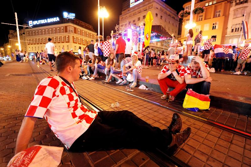 Croatian football fans pictured in the capital Zagreb's main square on June 23, 2014 after Croatia lost 3-1 in their final 2014 FIFA World Cup group A match against Mexico