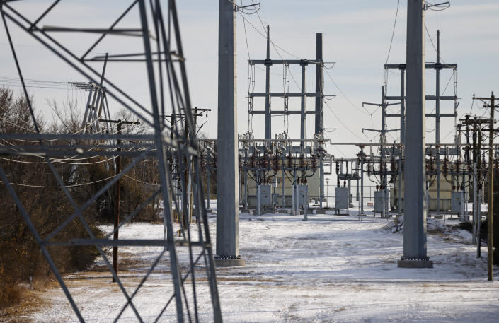 Transmission towers and power lines lead to a substation after a snow storm on February 16, 2021 in Fort Worth, Texas. (Photo by Ron Jenkins/Getty Images)